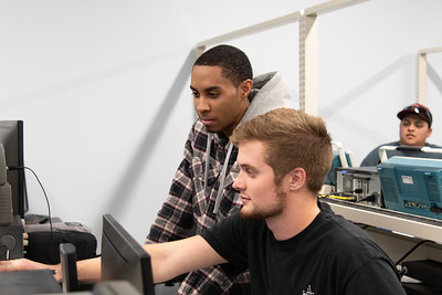 Carlos Santiago (left) and Brady Russell learning about the oscilloscope in their Circuit Analysis Lab.