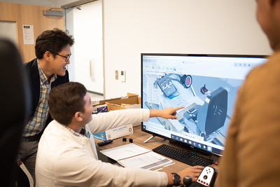 Joshua Rowe (right) goes over 3-Dimensional model to Professor Dr. Park at the Texas A&M Univeristy of Corpus Christi Engineering Labs.
