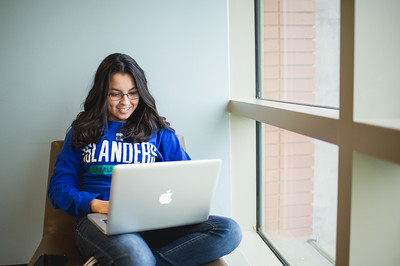 Stefanie Garcia works on her political science studies in the O'Connor Building.