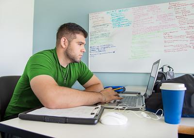 Jesus Herrera works on a Mechanical Engineering assignment.
