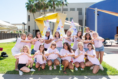 Members of the Tri Delta sorority pose for a photo in the Center for Instruction courtyard during the Get Your Greek On event.