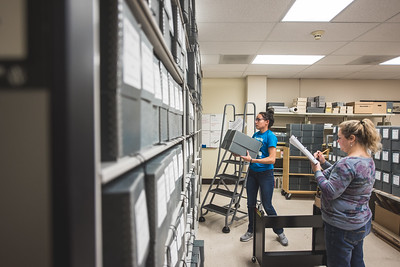 Shelby Gonzlez and Alston Cobourn take count of the Dr. Hector P. Garcia collection in the Special Collections and Archiving department at the Mary and Jeff Bell Library.