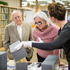 Laura Starr (right), shows Cecilia & Jim Akers an item from the Dr. Hector P. Garcia archive collection in the Mary and Jeff Bell Library's Collections and Archive department.