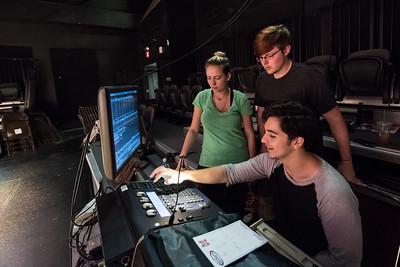 Students Savannah Stirling (left), Austin Nylander, and Christopher Niesner work on programming lights for Cloud9.