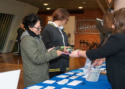Raquel Colon receives a Rafiki beaded friendship bracelet before the Fall 2018 Distinguished Speaker Series featuring Craig Kielburger, co-founder of the WE Movement, and Spencer West, motivational speaker, social activist and world change warrior.