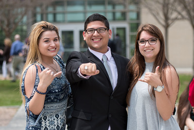 Katherine Garza (left), Austin Villanueva, and Amber Hargens pose for a photo during the Islander Ring Ceremony.
