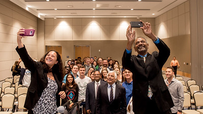 Panelists and students gather to take a selfie during the International Symposium Panel Discussion.