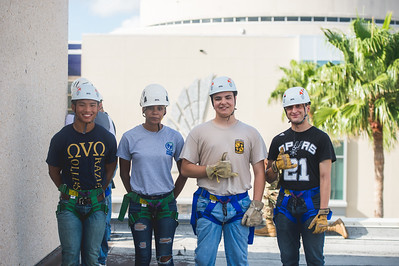 Christian Stavig (left), Taylor Magallanez, Steven Allbert and Daniel Farias pose for a photo prior to taking part in the ROTC rappelling event.