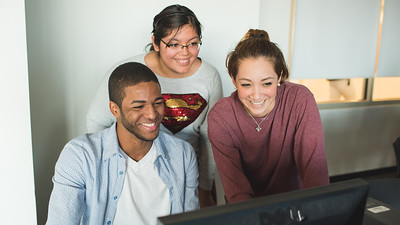 Javier Lorenzo(left) Daisy Espino and Kirsty Arvizu work on their English Comp in the O'Connor computer lab.