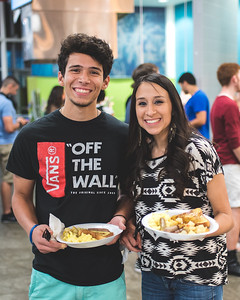 Ayman Abdalla and Julie Reyes grab a plate during the late night breakfast event in the Dining Hall.  More photos: https://flic.kr/s/aHskzBHpcz