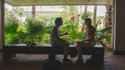 Zachary Baltazar(left) and Taylor Harris take a break between classes in the breezeway just outside the Mary and Jeff Bell Library.