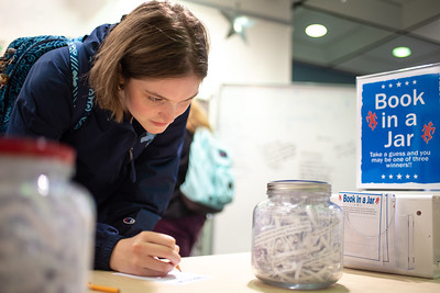 """Evelyn Kuhnel takes a guess at """"Book in a Jar"""" for a special prized raffle held by the Mary and Jeff Library in honor of Banned Books Week."""