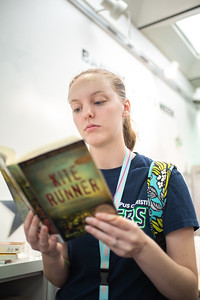 """Sarah McCurdy comes to support Banned Books Week at the Mary and Jeff Bell Library by reading over banned book """"Kite Runner""""."""