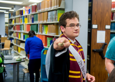 Student Connor Gray in costume of Harry Potter for the Open House event in the time of Banned Book Week