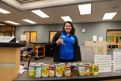 Magda Garza handling the food donations at the library.