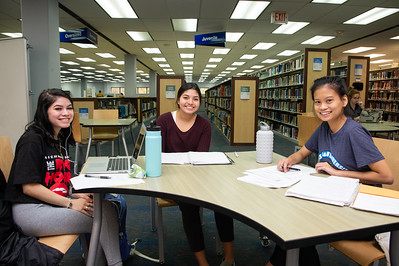 Larissa Lerma (left), Marisela Martinez, and Angel Galang studying for their History class.