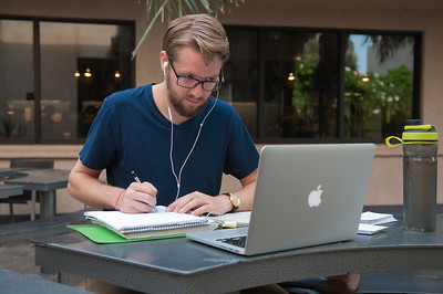 Jeff Boeck studying Financial Accounting outside of Starbucks.