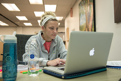 Student Tiffany Hawkins studies for her climate/physics final in the Mary and Jeff Bell Library.