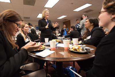 TAMU-CC President Kelly Quintanilla takes a moment to speak to students during lunch at the state capitol.