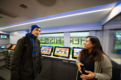 Kirk Jorgensen (left) is welcomed by Ivette Lucero Lopez to the C-Span Bus.