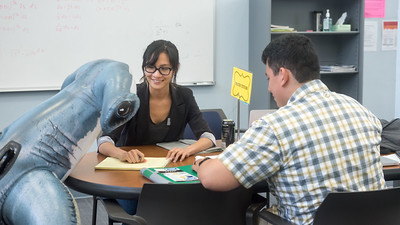 Math Tutor Tamara Truong helps Hunter and Islander Christopher Rios with Linear Algebra in the Center for Academic Student Achievement.  Join us in celebration of Shark Week at Brewster Street Icehouse: http://bit.ly/2taqLoa