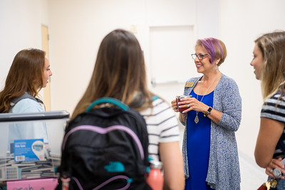 Professor Julie Fomenko greets students as they make their way their nursing class.