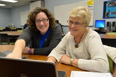 Casa tutor Kailin Johnson assits student Phyllis Loeffler with Excel Program.