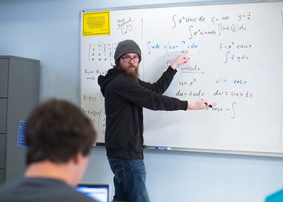 CASA tutor Devin O'Donnell explains some Differential Equations problems to a student.