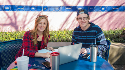 Sarah Writght and Zach Christiansen work on their Parasitology studies in the Hector P. Garcia plaza.