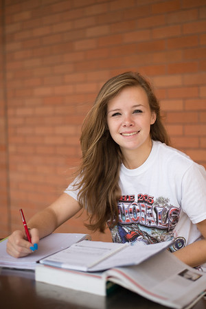 Student Kira Wideman, pauses for a portrait during her History homework.