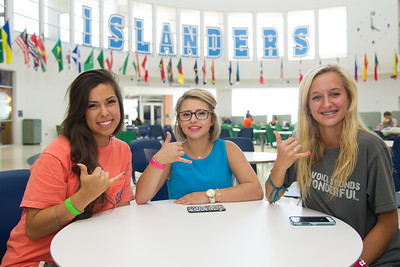 New students Lysette Lara(left), Autumn Balen and Erica Mynar show their Islander pride during the first day of orientation Thursday July 23 2015, in the University Center.