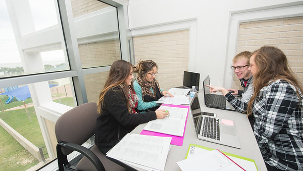 Maria Sanchez (left), Angelica Sanchez, Caleb Meyers, and Blake Brand study collaboratevly for their special ed - education final in the ECDC.