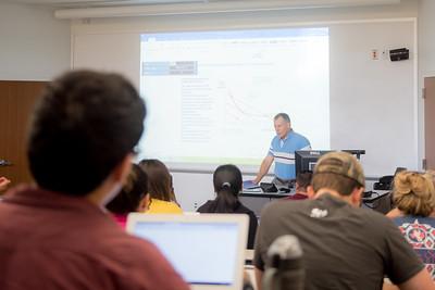 Professor D. Hudgins during a presentation for Macro Economics.