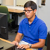 Kinesiology student Erik Soto utilizes the research computers in the library.