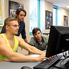Tanner Maxwell (left), Myles Cooky, and Hunter Mitchell working on their Physics assignment.