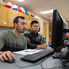 Reed Nelle (left) and Nghia Le work on their Physics I assignment.