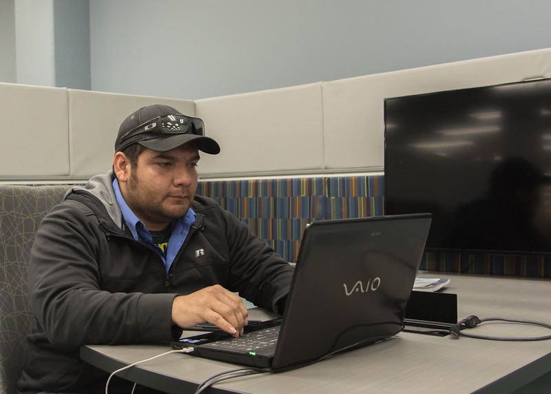 Student Richard Aguilera studies for Finance and Management .