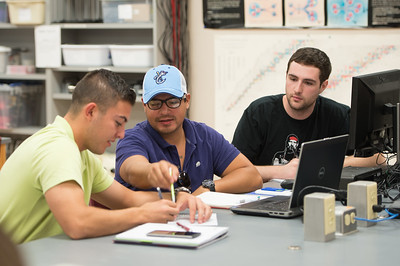 Miguel Bustos (left), Rudy Salomon and Adam Hennad work together during their Physics 1 class.
