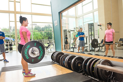 Leticia Zavala works on her form in her strength & conditioning for women class in the Dugan Wellness Center.