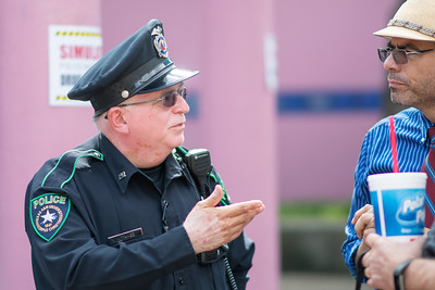 Retired UPD officer M. Tamez speaks to professor Gabriel Ferreyra, following a Drug Bust demonstration on campus.