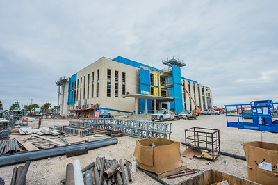 Construction continues as workers get close to finish applying brick on the exterior of the Tidal Hall buildilng.