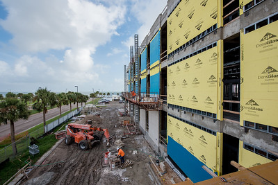 Tidal Hall construction continues as brick is placed on the west side of the building.