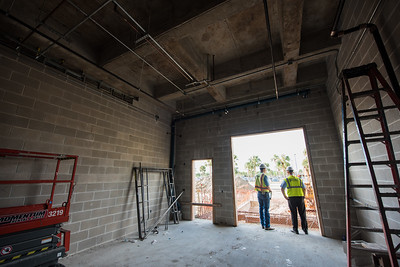 Asst. Project Manager Lawrence Gaertner (left) gives a tour to Director of Facillities Kevin Brown.