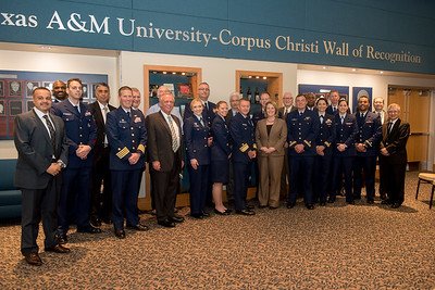 Guests from the United States Coast Guard gather for a photo with TAMU-CC administration, faculty, and staff in the University Center.