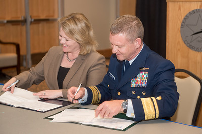 President and CEO, Dr. Kelly Quintanilla (left), and Rear Admiral Paul Thomas, Commander Coast Guard District Eight sign the MOA documents. Tuesday February 20, 2018 in the University Center.
