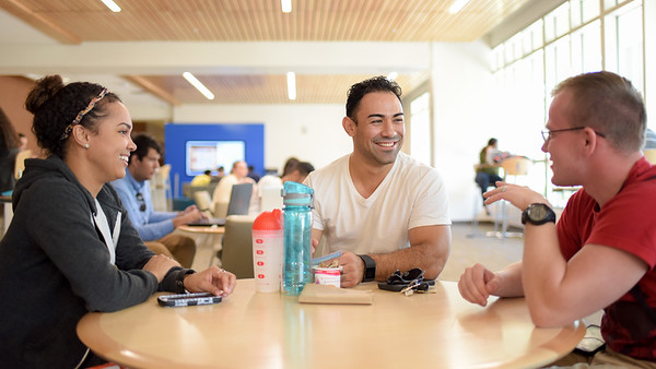 Angelyn Fryer (left), Jose Baldwin and Ryan Farris meet up in the Tejas Lounge before classes start.
