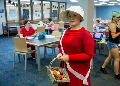 Student Kaitlyn Williams in costume of Offred for the Open House event in the time of Banned Book Week