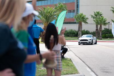 Corpus Christi, Texas - Spring 2020 Graduates pick up their diploma during the Texas A&M University-Corpus Christi Diploma Drive-Thru Parade.