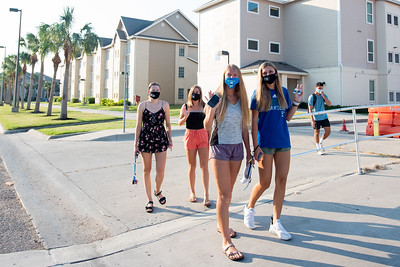 Students make their way from Miramar to campus on teh first day of the fall 2020 semester.