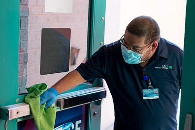 SSC staff member Ray Gonzalez cleans high contact areas during the first day of the fall 2020 semester.